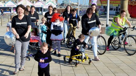 Family, friends and supports set off with Cohen from Lowestoft's South Pier. Photo: Mick Howes.