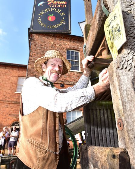 Apple Day at Gressenhall Farm and Workhouse museum of Norfolk Life.Stephen Fisher with his cider pr