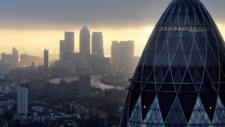 File photo of the 'Gherkin' and Canary Wharf at sunrise from the City of London, as TheCityUK warns