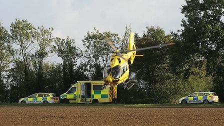 East Anglian air ambulnace attends the Scene of air craft crash in the village of Topcroft in Norfol