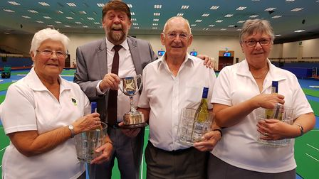 Potters Cup winners, from left, Ann Rawlings, Laurie Rawlings and Margaret Barley with Mark Brewer