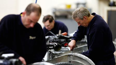 Output in Britain's manufacturing sector slipped in September amid a surge in costs linked to higher