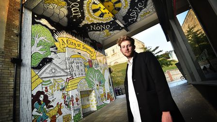 Norwich BID's latest City of Stories mural by Joey La Meche, pictured. Picture: ANTONY KELLY