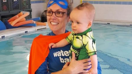 A child and mother in Norfolk taking part in the Water Babies' Splashathon fundraiser for Tommy's ba