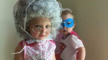 Two Norfolk children dressed up for the Water Babies' Splashathon in aid of Tommy's baby charity. Pi