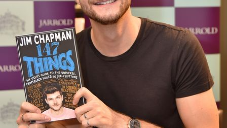 Popular blogger Jim Chapman signs copies of his new book at Jarrolds, fans queue for the opportunity