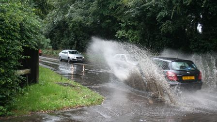 Flooding at Hellesdon Mill Lane junction with Hellesdon Road. Photo: Dave Cook.