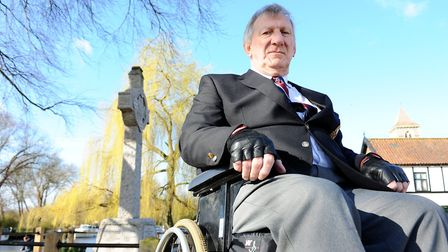David Freeman next to the war memorial on the River Green at Thorpe St Andrew