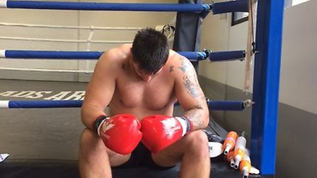 Sam Sexton takes a breather after 12 rounds of work at the gym. Picture: Chris Lakey