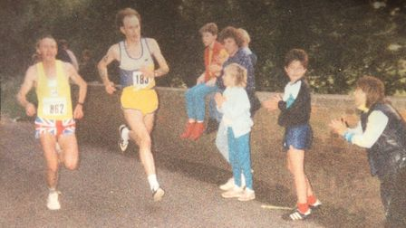 Neil Featherby running with Peter Duhig. Picture: Neil Featherby