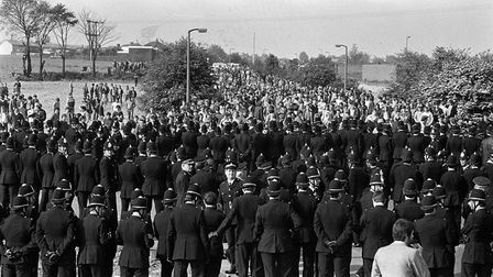 Police greeting pickets as they arrive on the hill heading to the Orgreave Coking Plant near Rotherh
