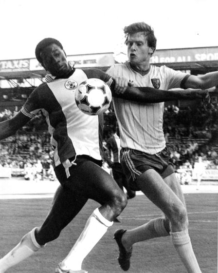 Steve Walford in action against former Norwich player Justin Fashanu. 13/09/1982 Photo: EDP pics