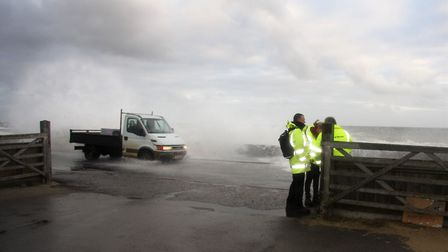 A flood warden and Enviornment Agency officials at Walcott. Pic: Maurice Gray.