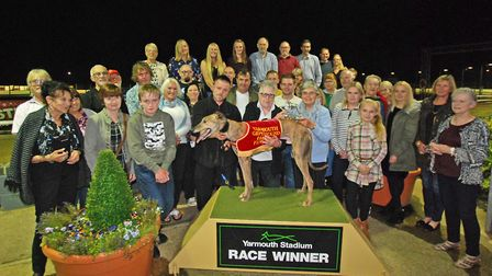 The Homefinders volunteers and the race winners at the track. Picture: Stephen Franklin