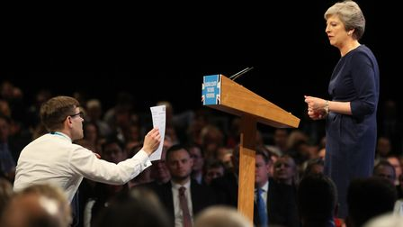 Comedian Lee Nelson confronts the prime minister Theresa May during her speech. Picture: OWEN HUMPHR