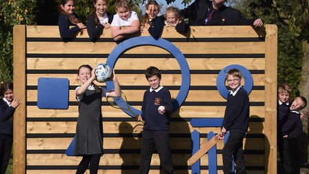 Bungay Primary School pupils and head teacher, Iain Owens, try out their new kick wall, which they h