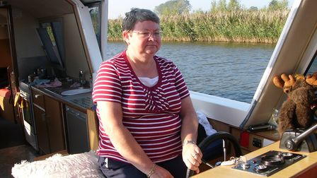 Jean Edwards at the helm. Picture: Courtesy Max and Jean Edwards