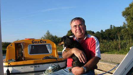 Max Edwards with the couple's current dog Pablo on a recent holiday on the Broads. Picture: Courtesy