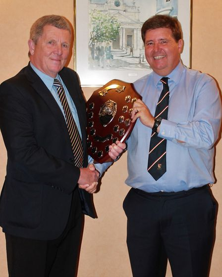 Mike Banham receives the Derek Cousins Memorial Shield from NYC chairman Neil Taylor. Picture: Lewis