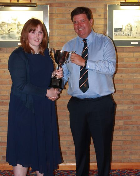 Robyn Edge receives the girls' player of the year award from NYC chairman Neil Taylor. Picture: Lewi