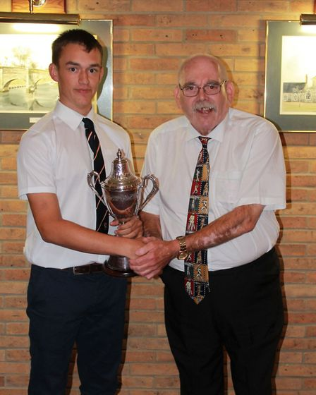 Callum Metcalf receives the Louis Brooks Memorial Trophy from Ross Brooks. Picture: Lewis Denmark