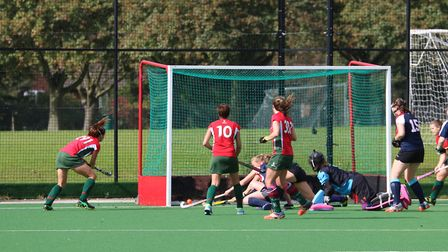 Katy Hands scores for Norwich Dragons in Saturday's 4-3 win over Cambridge City II in their opening