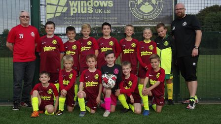 The Thorpe Rovers under 10s team with its new kit paid for by Windows Plus, based on Salhouse Road i