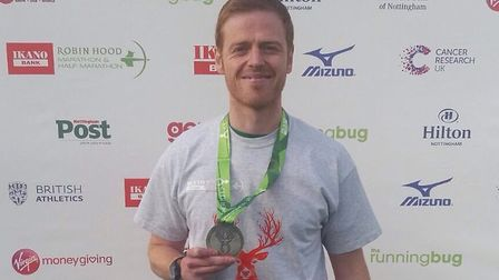 Mark Armstrong with his finisher's medal after getting a new personal best at the Robin Hood Maratho