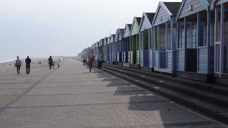 People walk along the prom in Southwold. Picture: SARAH LUCY BROWN
