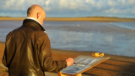 Andrew Horrod painting at Paint Out Wells beach sunrise. Picture: Katy Jon Went