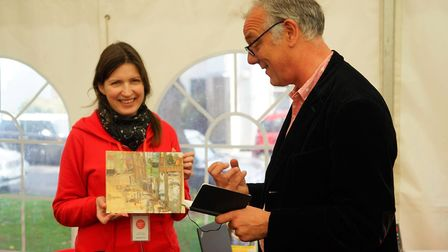 Judge Nick Holmes discusses Second prize winning painting 'Blakeney Hard' by Artist Sam Robbins. Pic