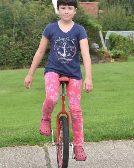 Patience Sadler from Besthorpe is going to do a sponsored unicycle to raise money for Norfolk Greyho