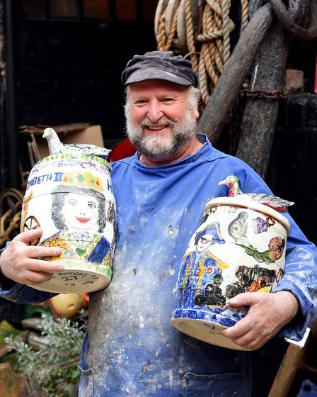 Ernie Childs from the Great Yarmouth Potteries with two of the painted pottery barrels made and deco