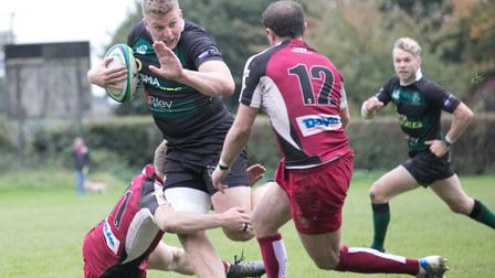 James Knights prepares to fend off an Amersham tackle. Picture: Hywel Jones