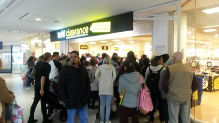 Customers congregating outside Tofs clearance store prior to opening. Photo: Jacob Massey