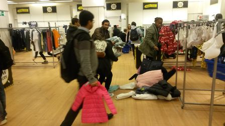 A customer dropping her shopping at the Tofs clearance sale. Photo: Jacob Massey