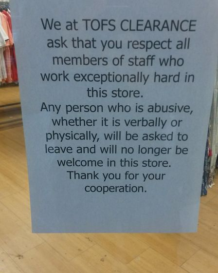 A sign in the window of the Tofs clearance sale asking customers to be respectful. Photo: Jacob Mass