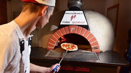 Paul Jackson working with the oak fired pizza oven inside the Royal Oak Pub, Beccles.Picture: Nick