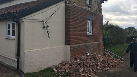 A lorry carrying a load of pigs crashed into a historic home in Forncett St Peter. Picture: Stuart A