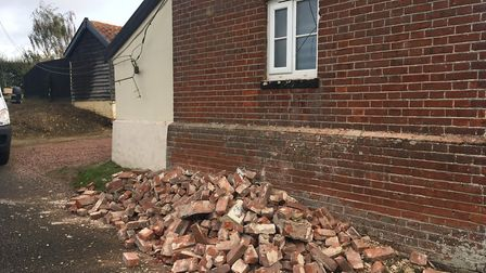 A lorry carrying a load of pigs crashed into a historic home in Forncett St Peter. Shown is damage i