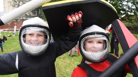 Zachary Wells, 10, left, and Holly Longley, nine, ready to battle each other in medieval combat at t