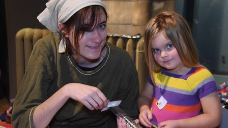 Beatrix Lloyd-Peck, three, makes a sword with help from Rachel Daniel, learning assistant, at the Sa