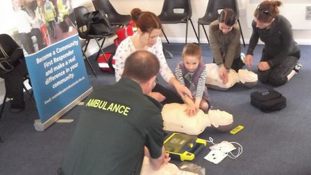 First Responders guide youngsters in first aid sessions.