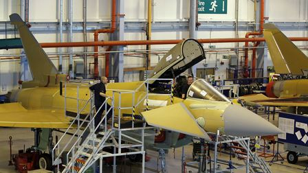 Employees at work on a Eurofighter Typhoon at BAE Systems, Warton Aerodrome, Lancashire. BAE System