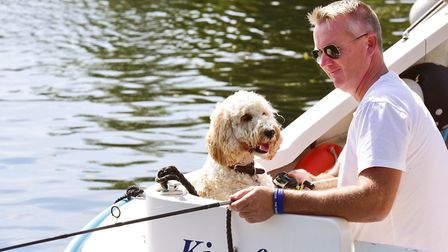 Chris Green fishing with his dog Bailey on the river at Coltishall on the August Bank Holday. Pict