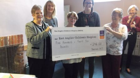Dereham WI president, Christine Humphries, presenting the cheque for £546 to Emma, EACH community fu