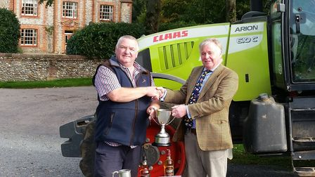 William Mack, of Hempstead Hall, is presented with the spring and winter barley competiton trophies