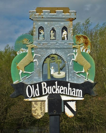 Old Buckenham village sign. Photo taken by Andrew Tullett as part of his Signs of a Norfolk Summer p