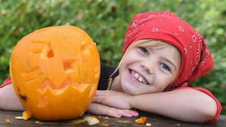 Pirate Eden Byrne, seven with her carved pumpkin at the Pumpkin Festival at the Brandon Country Park