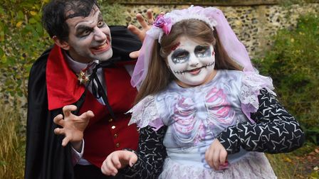 Graham Morgan from Shoestring Theatre Productions, and Hannah Scandrett, eight, in their halloween c